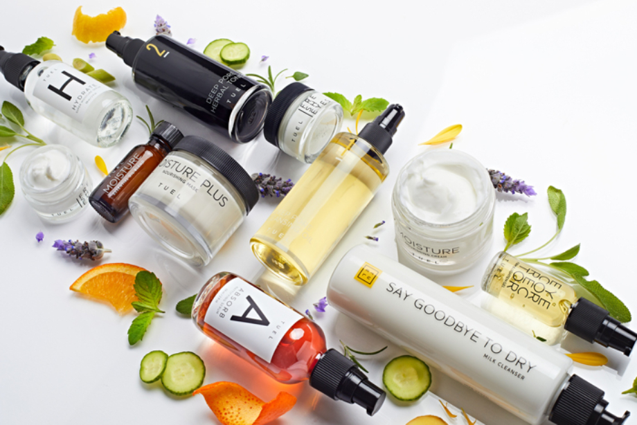 Tuel Skincare line arranged with natural ingredients around the products shot by Chava Oropesa for Tuel