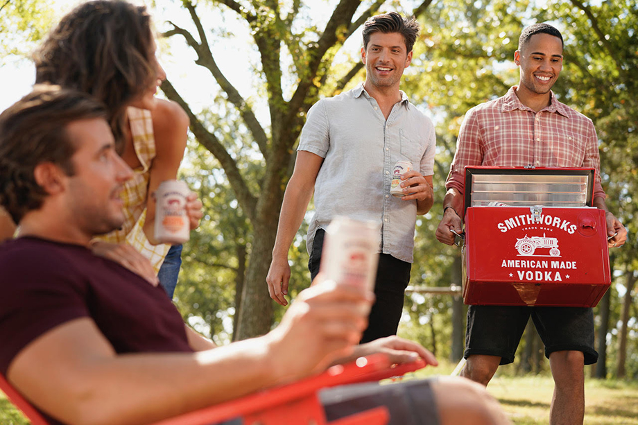 Motofish photographs a group of friends enjoy Smithworks Vodka Hard Seltzer Lemonade outside.