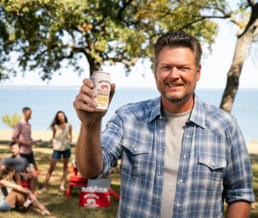 Motofish photographs Blake Shelton holding up a Smithworks Vodka Hard Seltzer Lemonade.