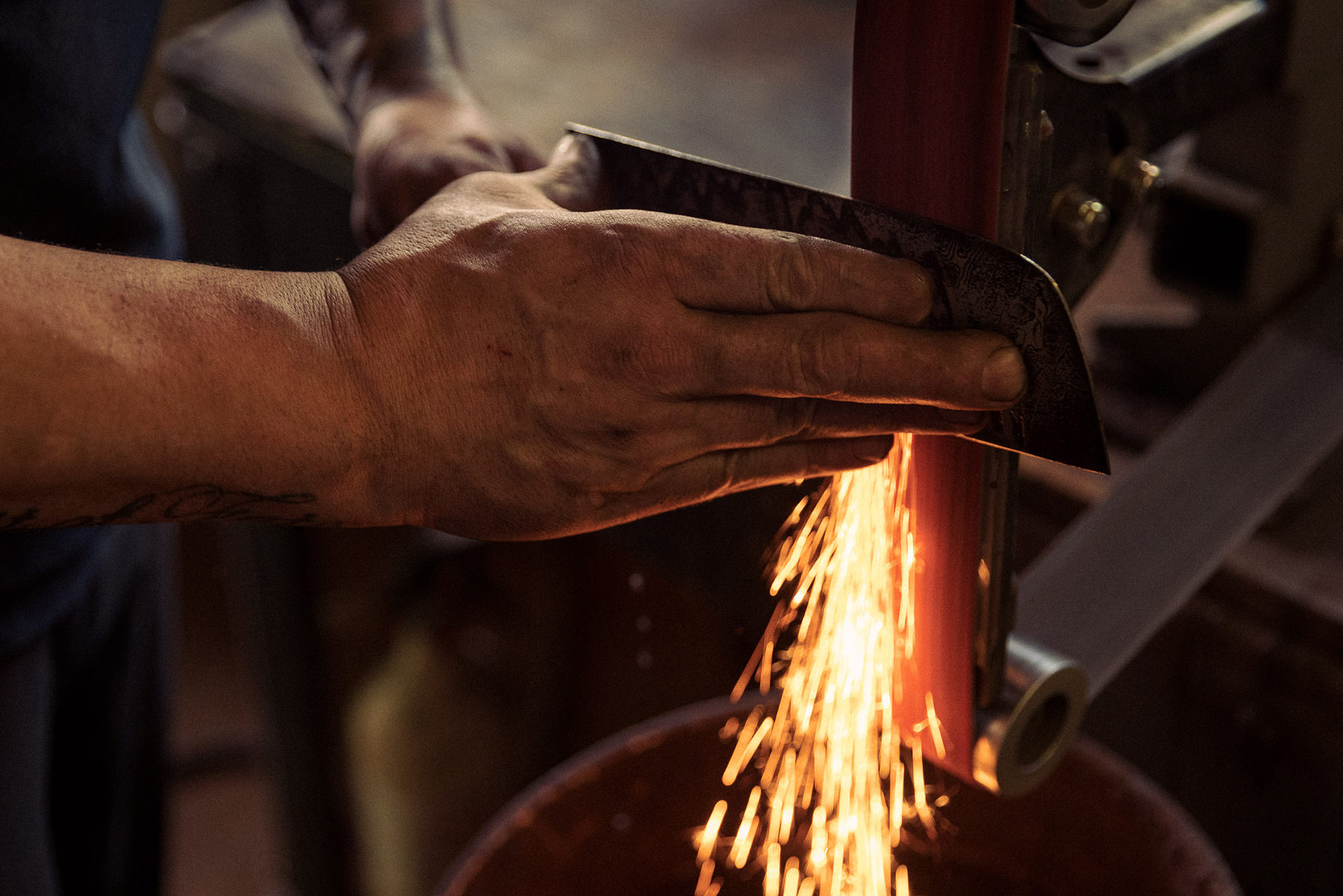 Sparks fly in metal workshop shot by Christian Tisdale for Makers series