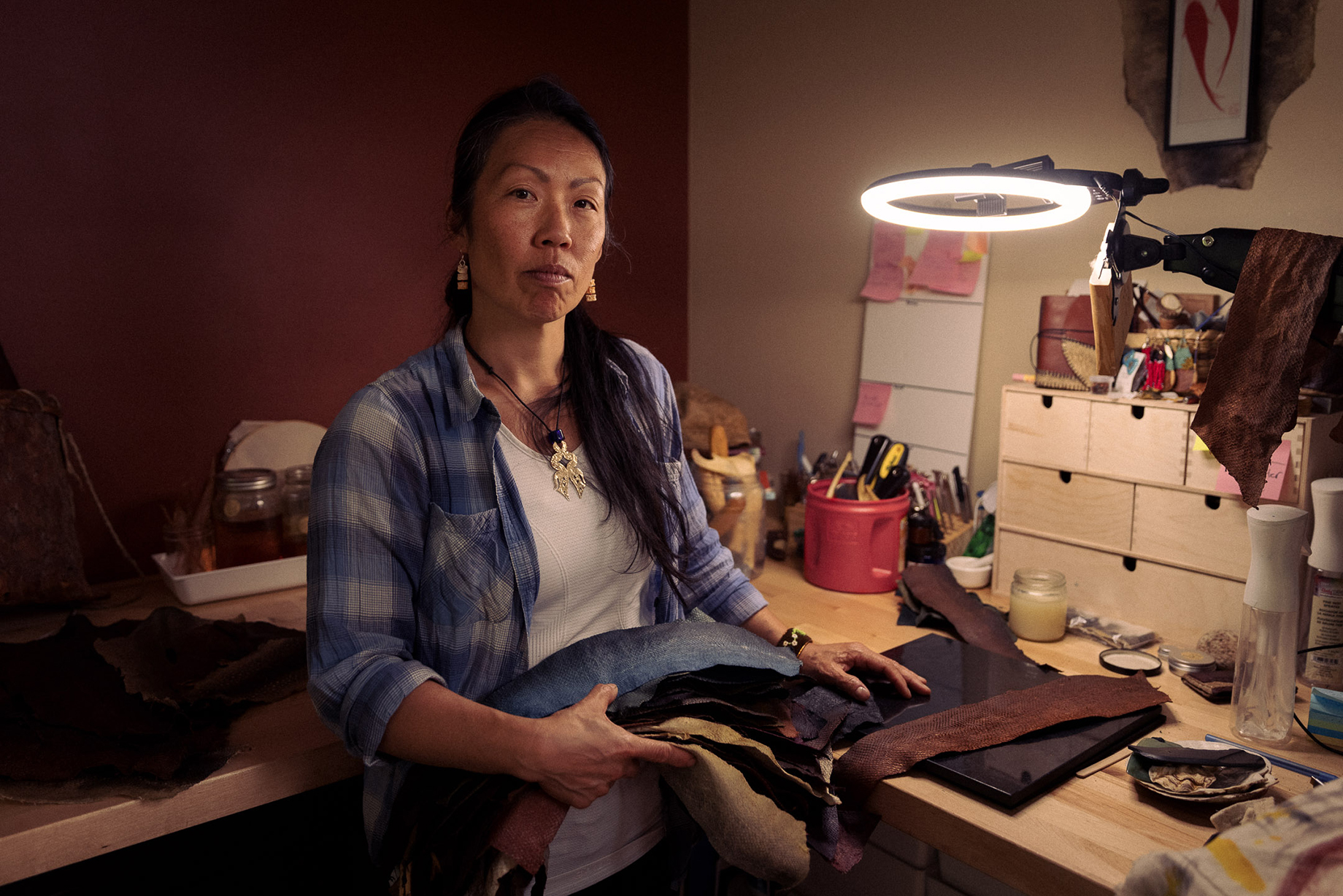 Fish-leather craftswoman Janey at her work table shot by Christian Tisdale for Makers series
