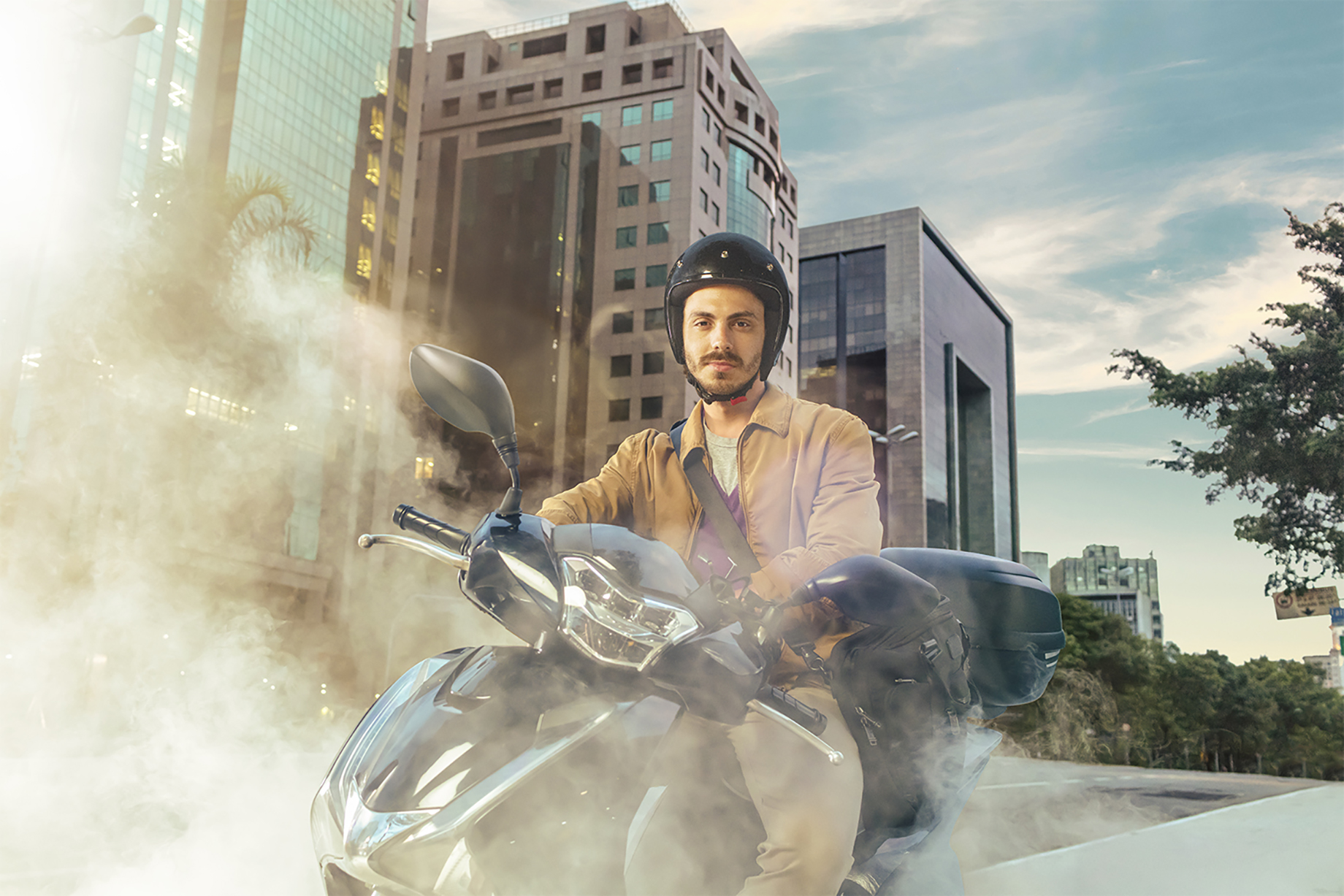 Portrait of a man riding motorcycle with dust around him shot by Claus Lehmann for Allegra campaign