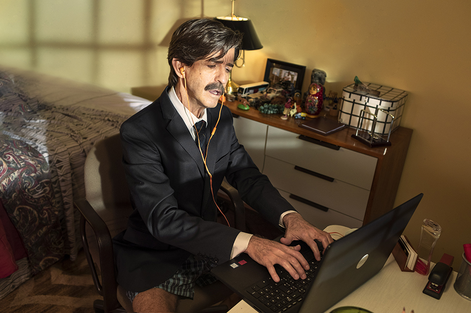 Image of man listening to music and typing on his computer while at work in his underpants. Photographed by Claus Lehmann for Spotify Brazil.