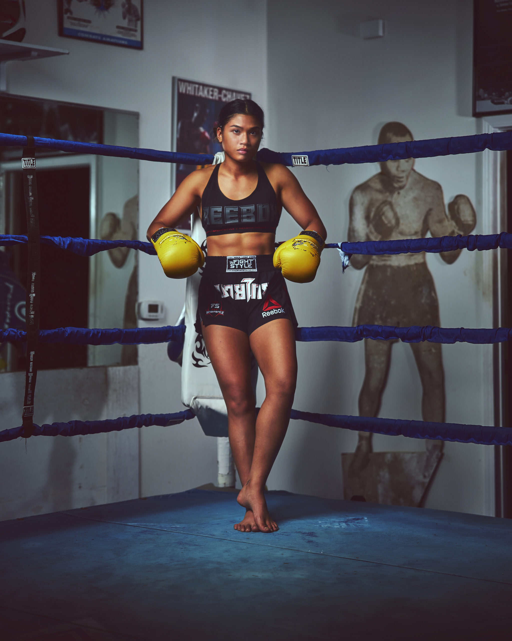 Jeff Dojillo photographs Jackie Buntan lounging against the ring in a Reebok sports bra and Inflghtstyle shorts