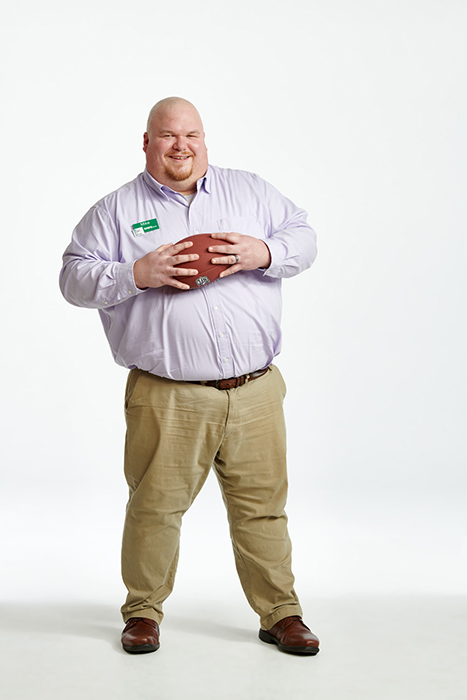 Michael Muller, a WSFS Banker holds a football to illustrate his love for the Birds. Photographed by Dave Moser.