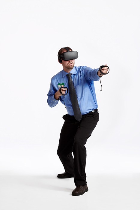 Matthew Myrick using a VR headset. Photographed by Dave Moser.
