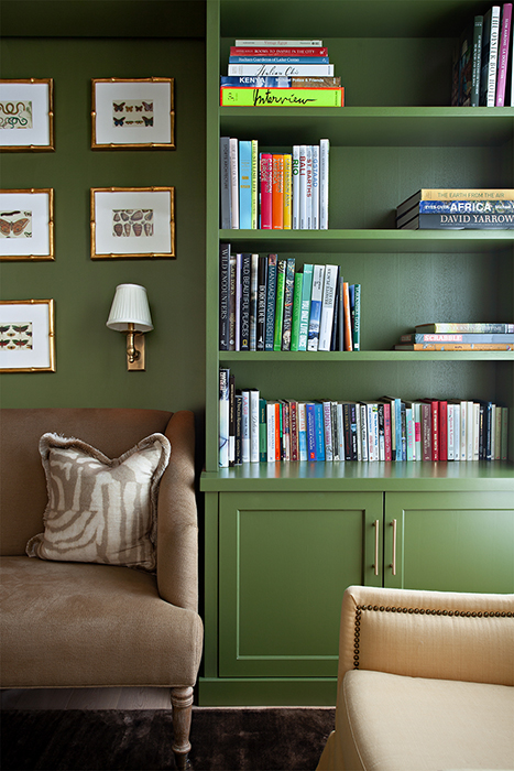 Denice Hough photographs A bright green bookcase adds a pop of color to the room.