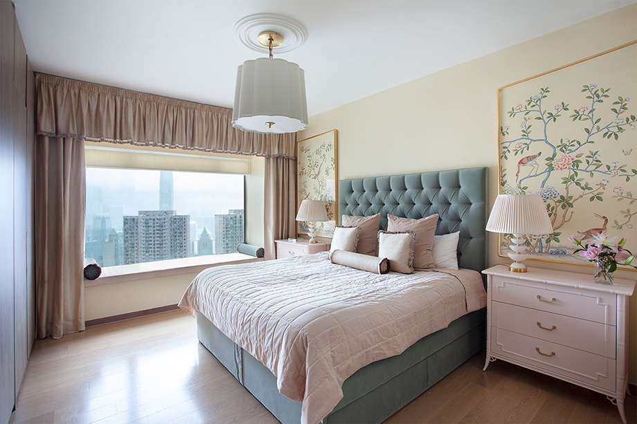 Denice Hough photographs a serene bedroom in light hues and comfortable fabrics overlooks the cityscape.