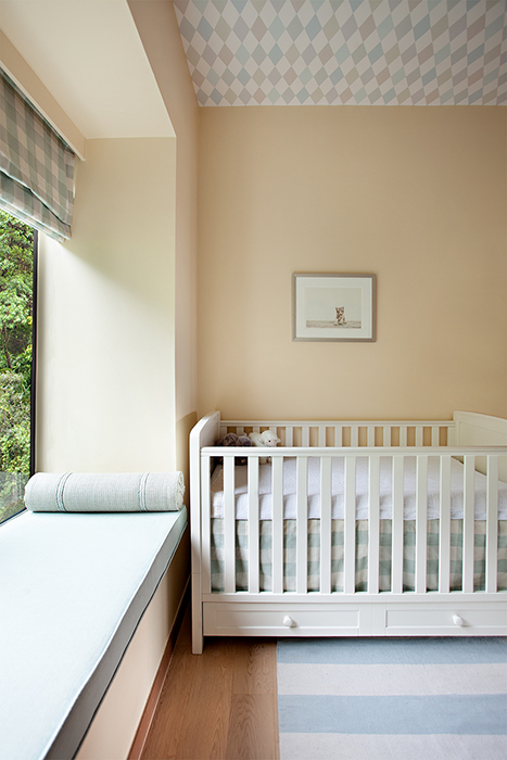 Denice Hough photographs child's bedroom with a crib.