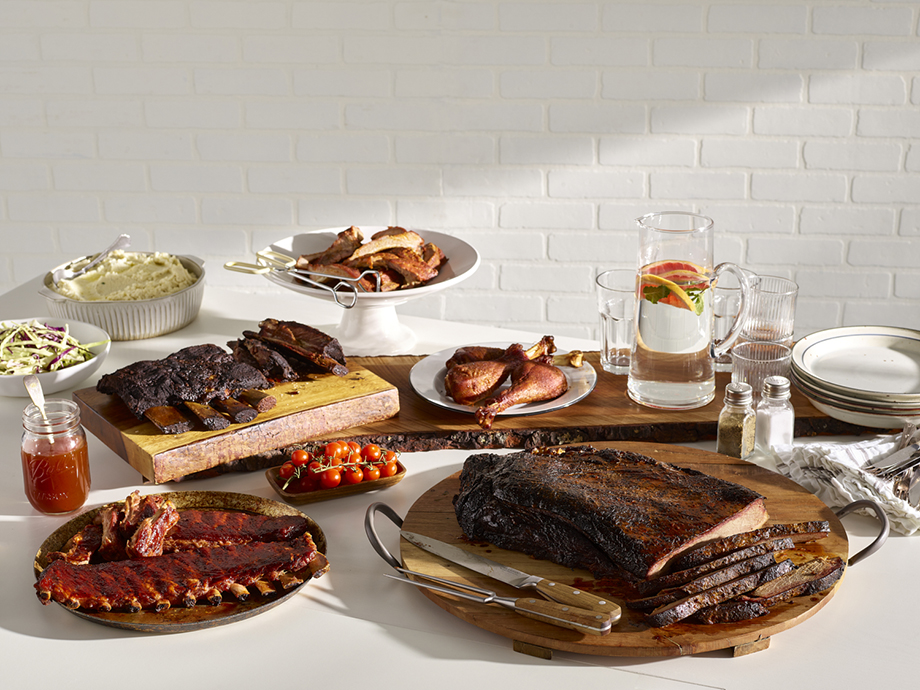 A spread of several barbecue dishes. Photography by Dhanraj Emanuel for Keto BBQ, food photographer, food photography, cookbook food photography, keto diet cookbook, keto recipes, keto bbq, cookbook illustration, food styling, food stylist, cookbook photographer, cookbook photography, phoode