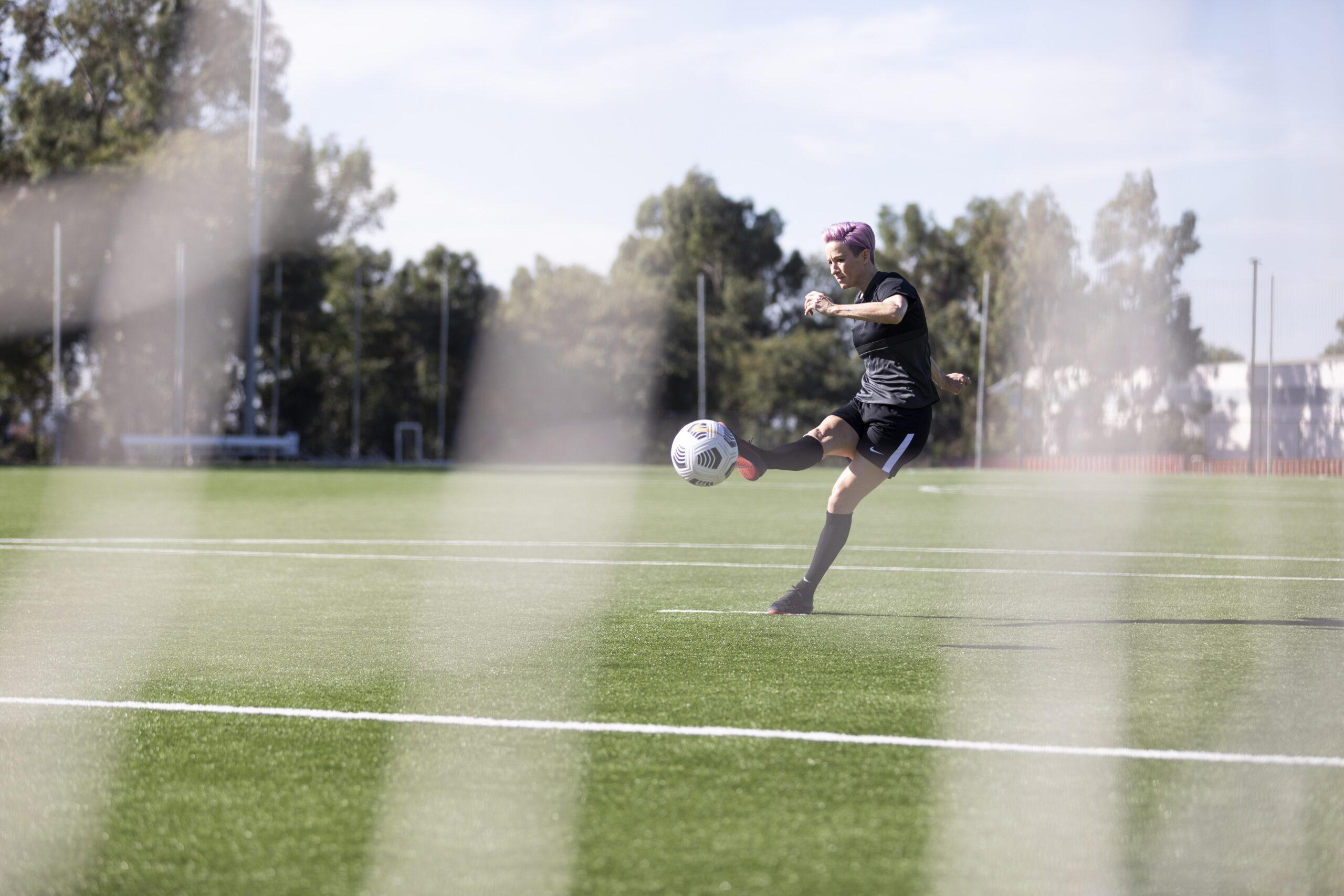Sabrina Hill photographs Megan Rapinoa as she shoots she scores for the Skills