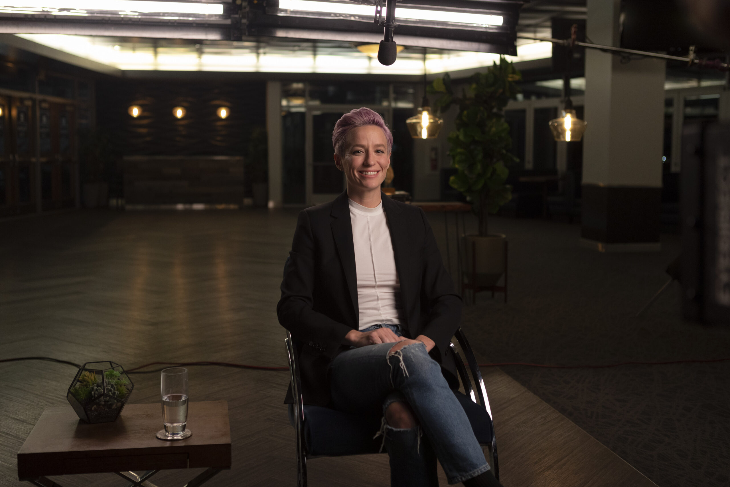 Sabrina Hill photographs Megan Rapinoe with a film crew for the Skills