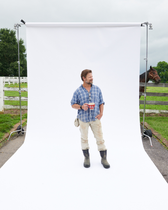 Behind the scenes shot of Steve Zahn in front of white backdrop shot by Egan Parks for the Hollywood Reporter