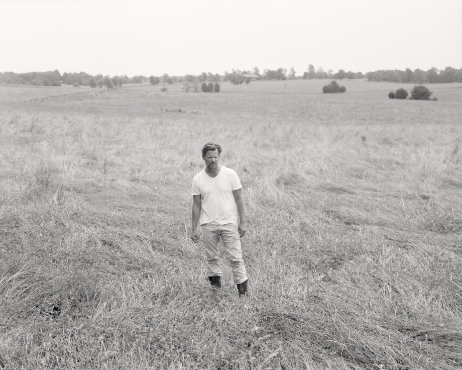 Film portrait of Steve Zahn in a grassy field shot by Egan Parks for the Hollywood Reporter