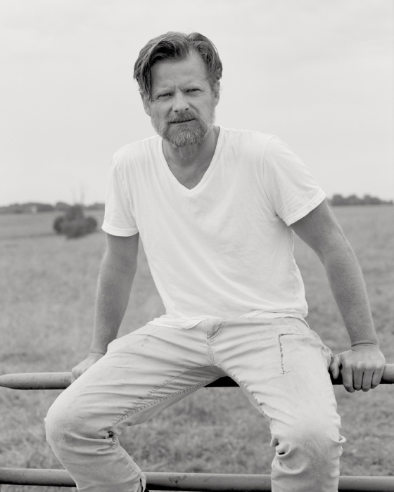 Film portrait of Steve Zahn sitting on a fence shot by Egan Parks for the Hollywood Reporter