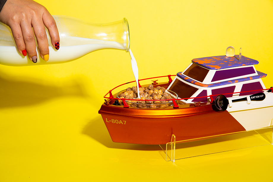 Milk being poured into the little yatch's milkcuzzi. Photographed by Emily Malan for Reese's Puffs.