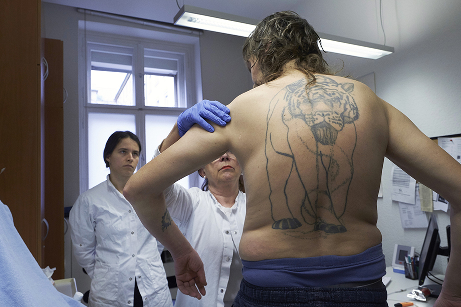 A man being examined by medical staff. Photographed by Enno Kapitza