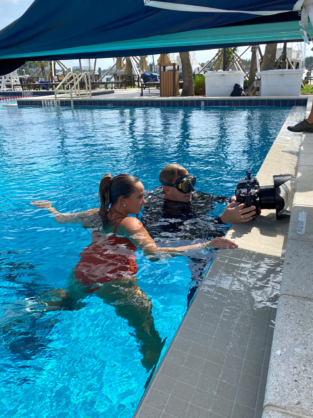 Behind the scenes shot of George Kamper and Kristina Makushenko collaborating for Venice magazine feature