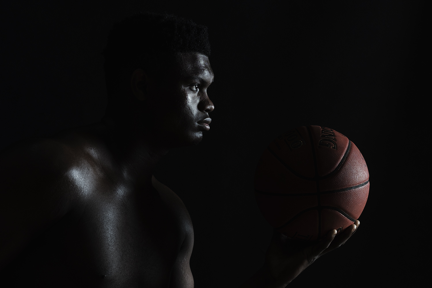 Ian Curcio photographs NBA star Zion Williamson portrait with a basketball