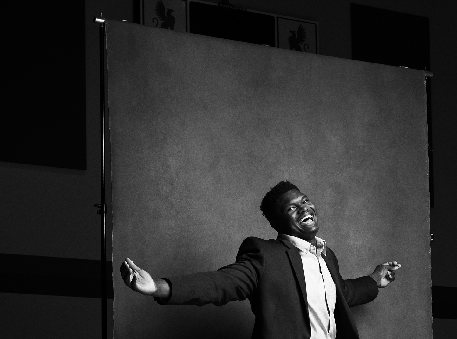 Ian Curcio photographs a jovial NBA star Zion Williamson in a suit