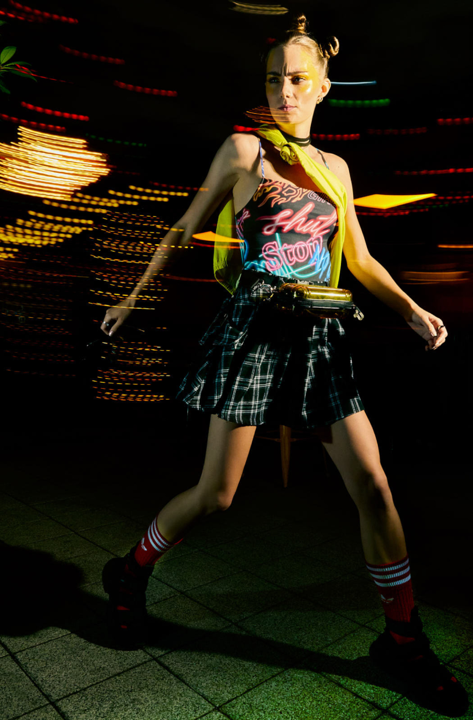 Model Reka Fedra with light trails behind shot by Illya Ovchar for Glamour Hungary