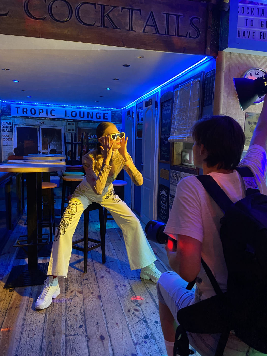 Behind the scenes shot of model Reka Fedra in blue light bar shot by Illya Ovchar for Glamour Hungary