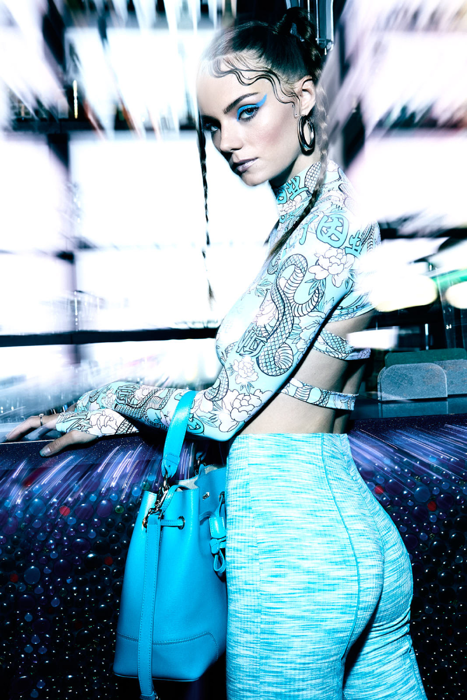 Model Reka Fedra in front of a backlight bar shot by Illya Ovchar for Glamour Hungary