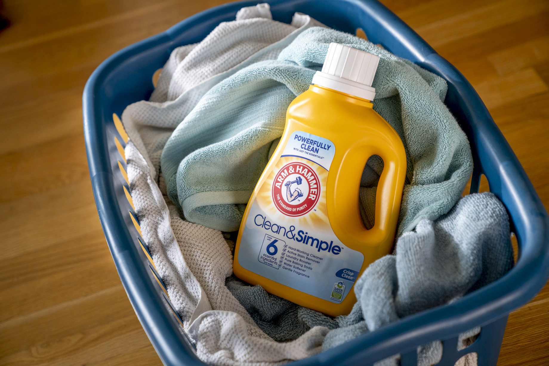 A basket of freshly laundered towels and Arm and Hammer detergent shot by Inti St. Clair