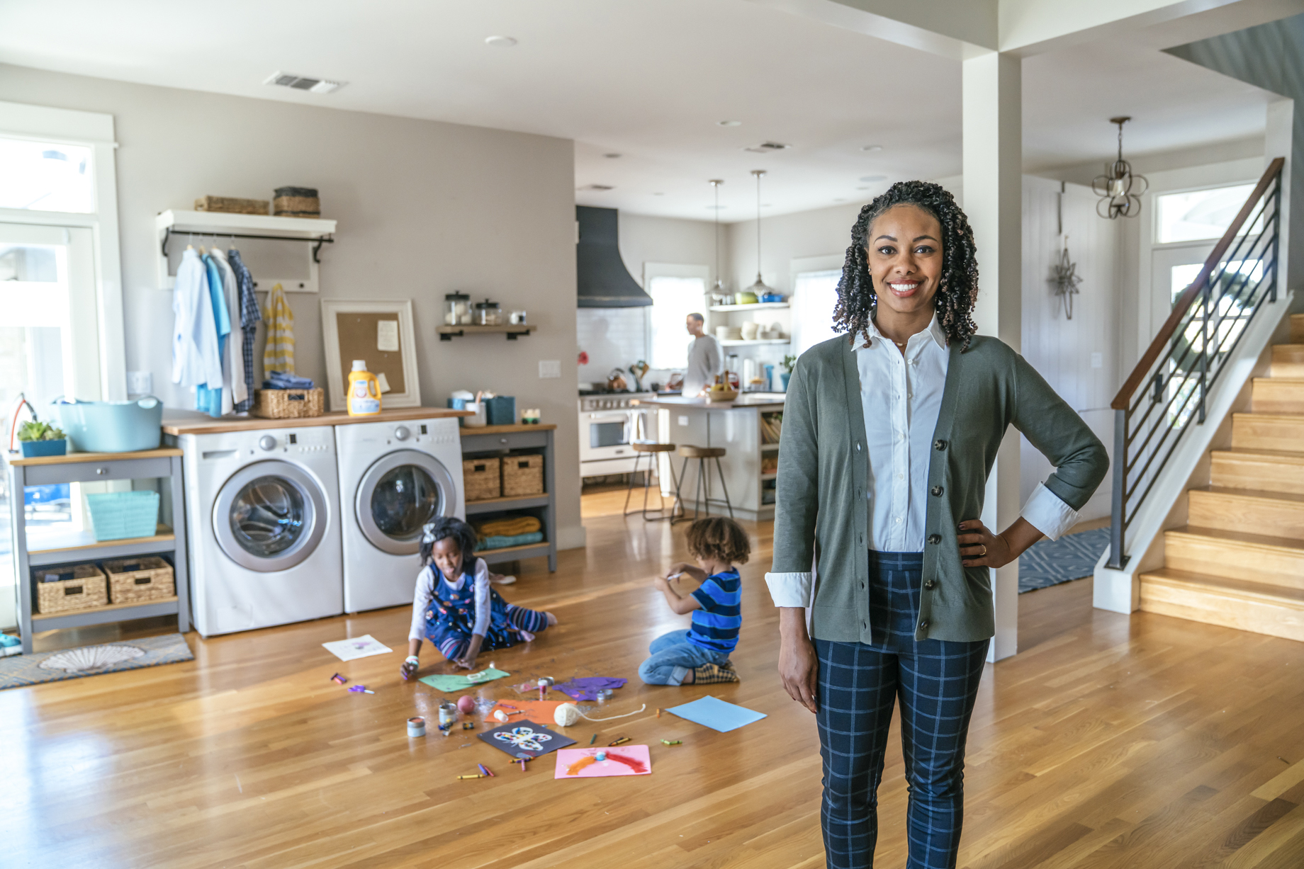 Portrait of a mother with two kids making art in the background shot by Inti St. Clair for Arm and Hammer