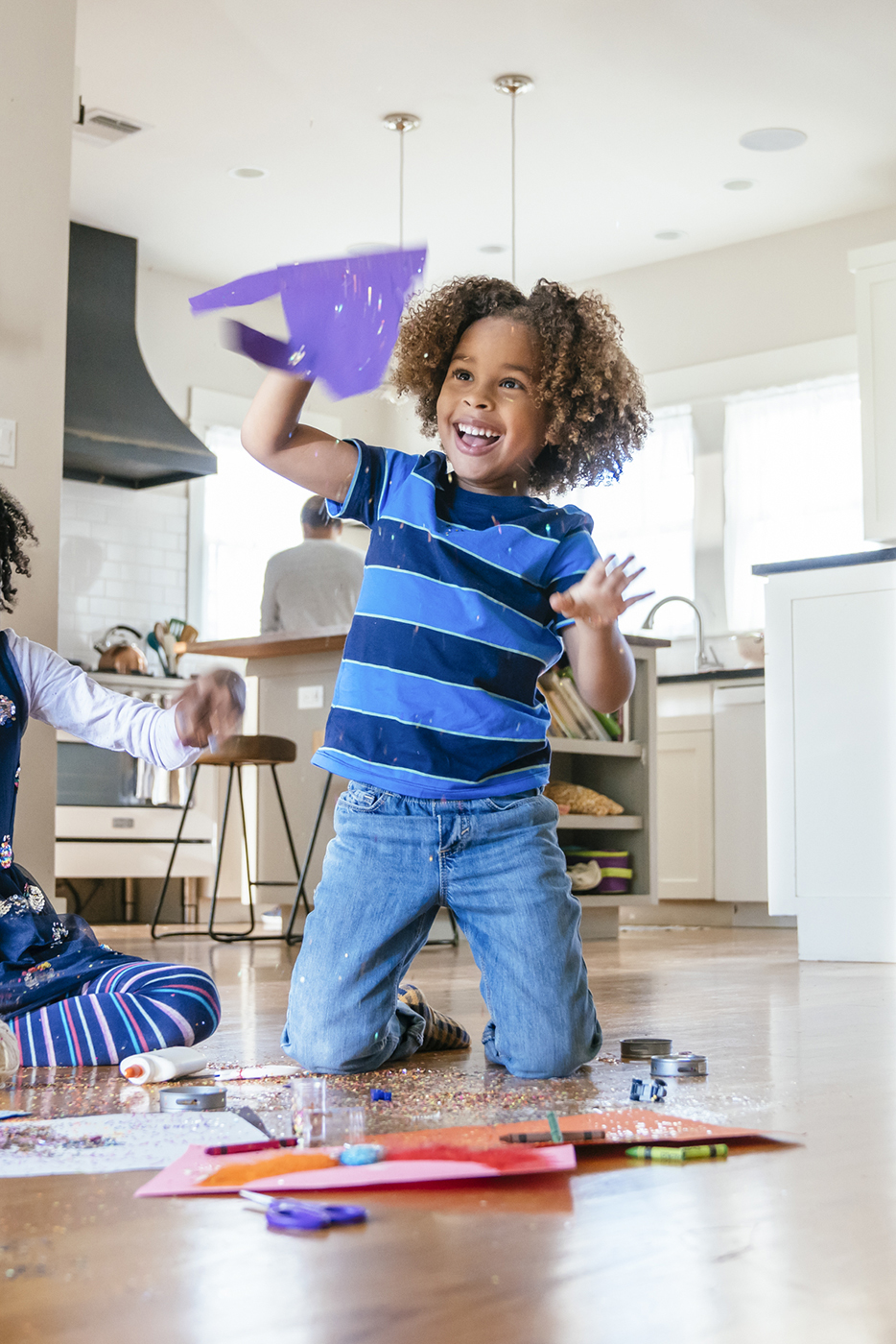 Young boy making a glittery mess shot by Inti St. Clair for Arm and Hammer Clean and Simple laundry detergent