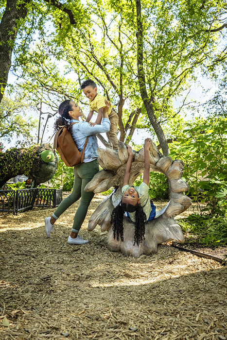 A family visits the Rory Myers Adventure Garden. Photography by Inti St. Clair for Visit Dallas.