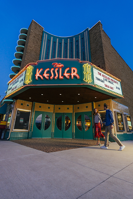 A couple walks towards The Kessler Theatre. Photography by Inti St. Clair for Visit Dallas.