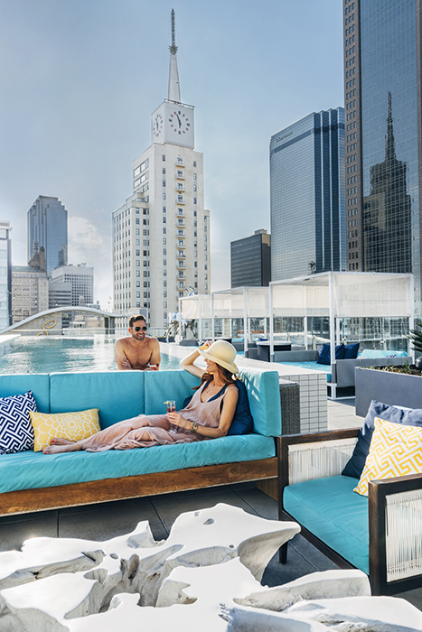 A male and female poolside. Photography by Inti St. Clair for Visit Dallas.