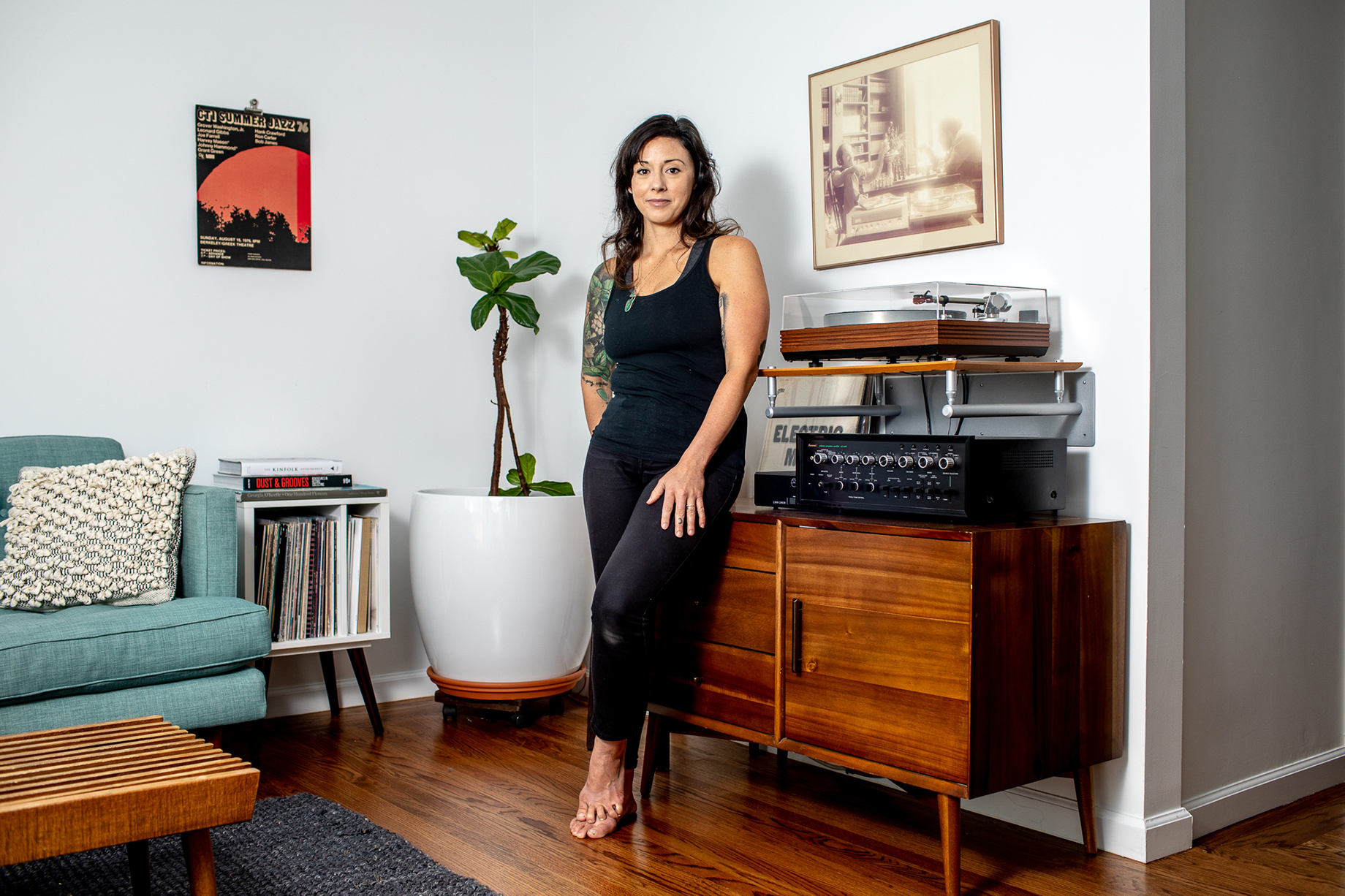 Woman leaning next to her record player shot by Jaime Borschuk for Women at Home project