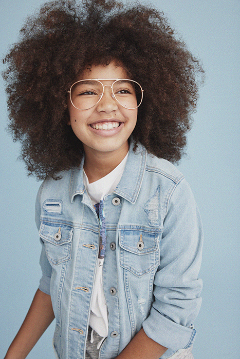 Kid smiling at the camera. Photographed by Janelle Bendycki for Abercrombie Kids.