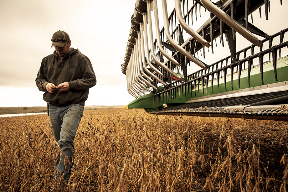 A man walks through the rural farms of North Dakota. Photography by Jason Elias