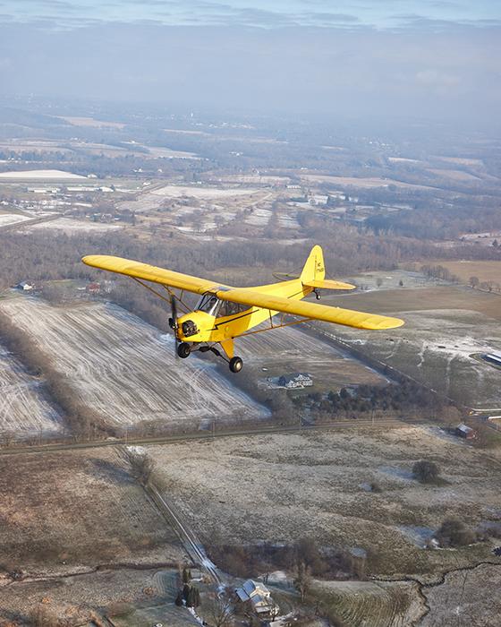 Plane in flight. Photography by Jeremy Kramer
