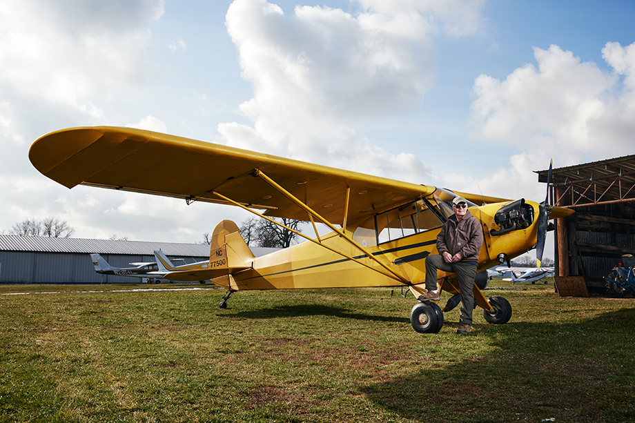 """Emerson """"Cub"""" Stewart and his plane. Photography by Jeremy Kramer."""