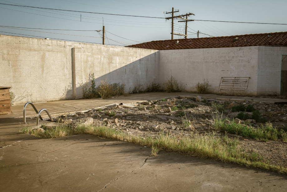 Filled in pool of Ropers Motel site of Pecos Jane mystery shot by John Davidson for Texas Monthly