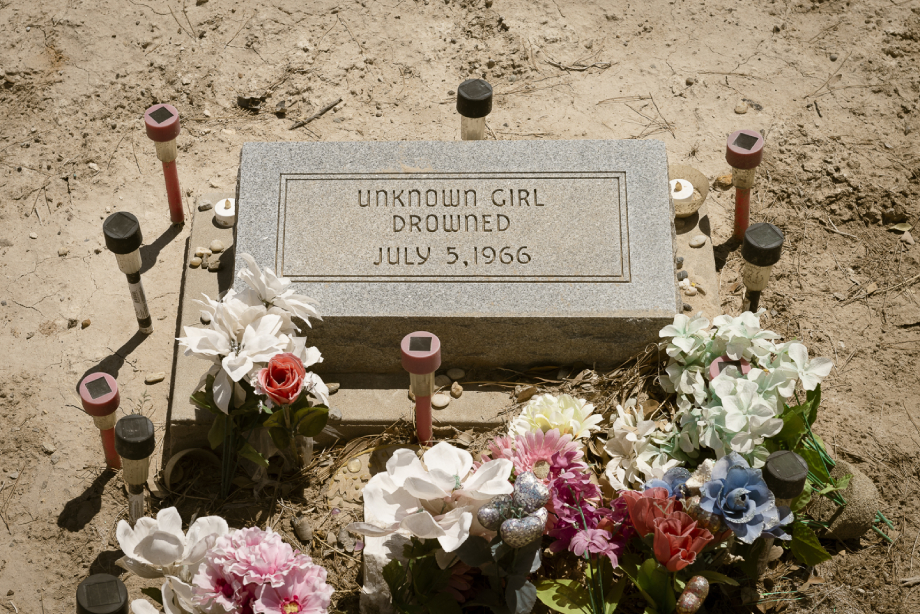 """Grave of Pecos Jane marked """"Unknown Girl, Drowned July 5, 1966"""" shot by John Davidson for Texas Monthly"""