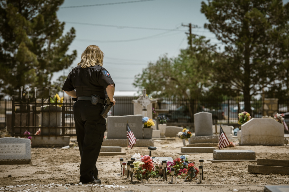 Chief of Pecos police Lisa Tarango viewing Pecos Jane's tombstone shot by John Davidson for Texas Monthly