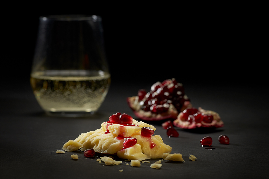 Close up of cheese pairing with wine. Photographed by John Valls for Tillamook Creamery.