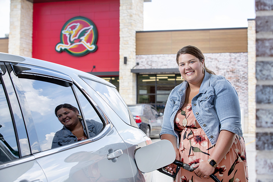 Woman pumping gas photographed by Karen Segrave for Coulson Oil.