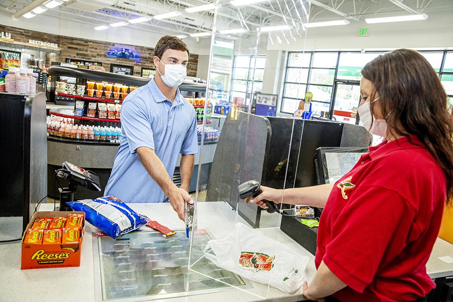 Roadrunner store clerk and customer photographed by Karen Segrave for Coulson Oil.