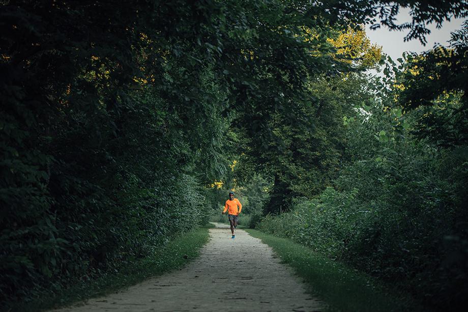 Kevin Serna photographs Coree as he runs through the trails.