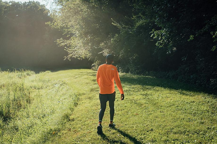 Coree Woltering walks through a lush green trail. Taken by Kevin Serna