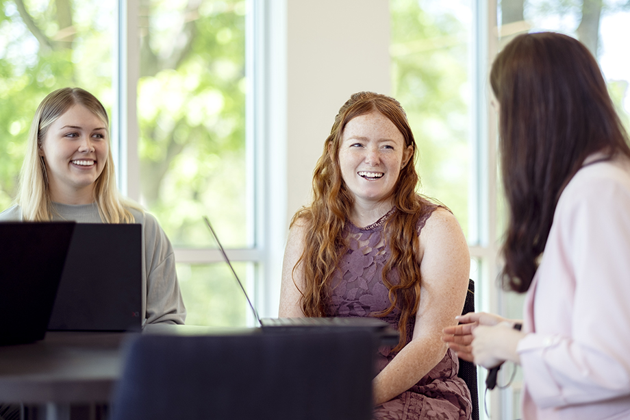 Genuine smiles during a meeting at Light Wave Dental. Photography by Kevin Titus Photo for Light Wave Dental.