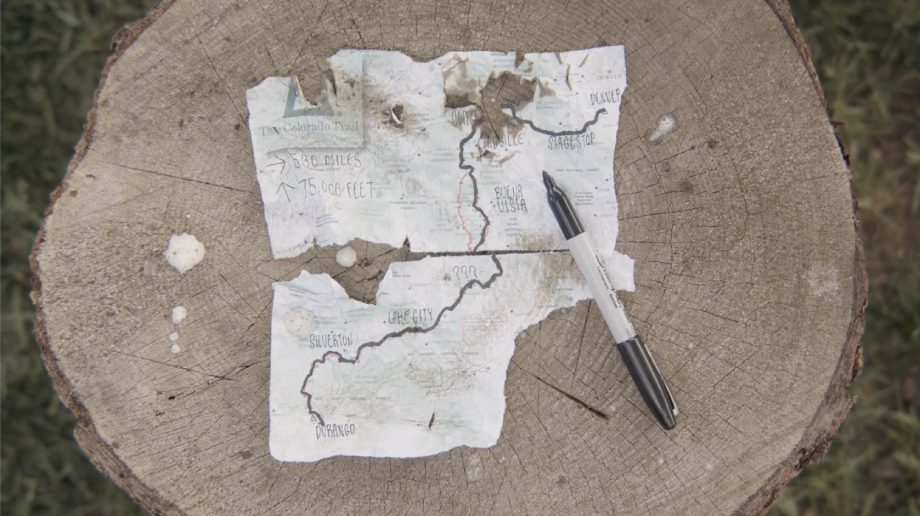 Torn and dirty map of the Colorado Trail marked from Denver to Durango from Kody Kohlman's film C-Team shot for Fat Tire