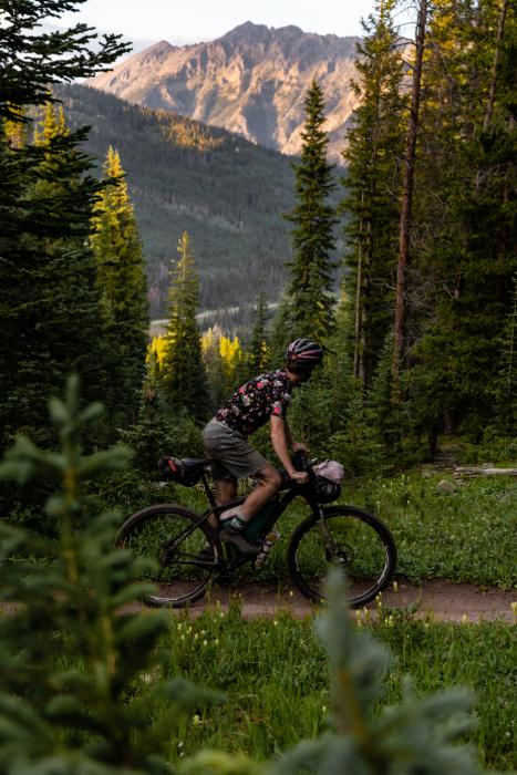 One biker looks left as he passes a mountain ridge from Kody Kohlman's film C-Team shot for Fat Tire