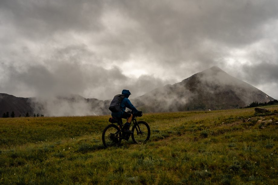 A lone biker travels over a foggy hill from Kody Kohlman's film C-Team shot for Fat Tire